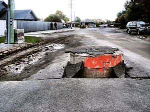300px-Storm_drain_pushed_up_through_road_in_the_2010_Canterbury_earthquake